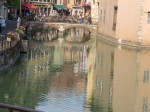 Its canals reflect city life.