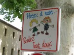 "But they also give insight into a culture (""Think of us, drive gently,"" reads this Lourmarin sign.)."