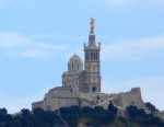 The Marseille basilica, devoted to protecting the city's seafarers, rises above high above the port.