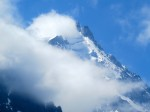 Afternoon clouds engulf the Aguille de Midi above Chamonix.