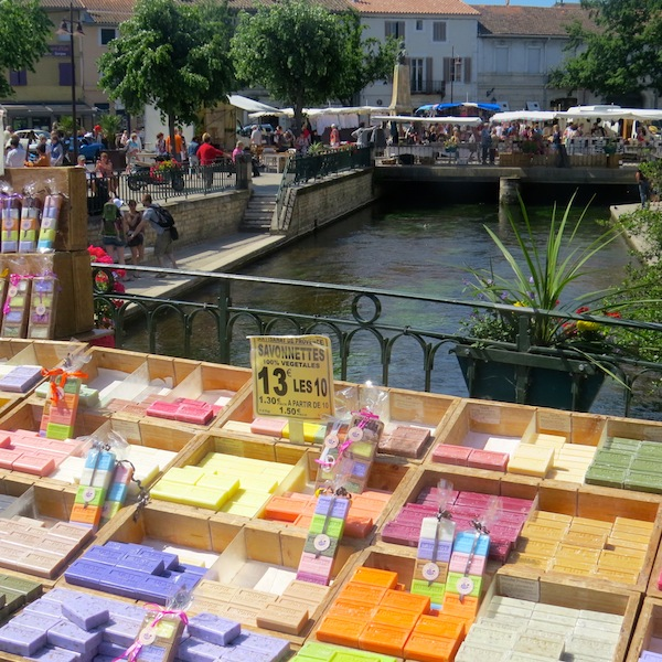 On Sundays in l'Isle-sur-la-Sorgue, vendors spread their wares