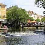 Every Sunday, the banks of the Sorgue River fill with merchants.